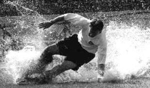 Splash! Sir Tom Finney, Preston North End and England, at Stamford Bridge in 1955. PNE's most celebrated player with a Stand and the road leading to the ground named after him.